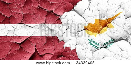 Latvia flag with Cyprus flag on a grunge cracked wall