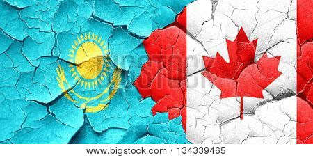 Kazakhstan flag with Canada flag on a grunge cracked wall