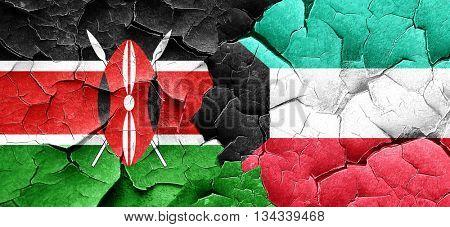 Kenya flag with Kuwait flag on a grunge cracked wall