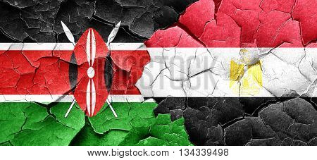 Kenya flag with egypt flag on a grunge cracked wall
