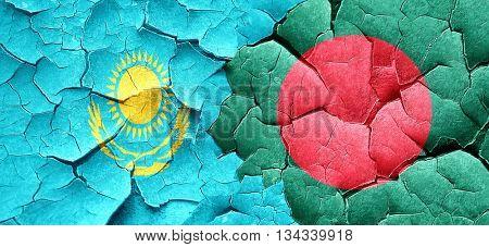 Kazakhstan flag with Bangladesh flag on a grunge cracked wall