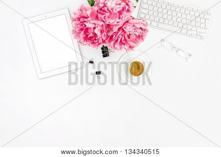 Mockup with digital Tablet PC. Feminine Home office workplace with coffee. Flat lay for social media blogger poster