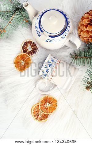 Christmas background. Decorations, cones, gift boxes on white wooden background