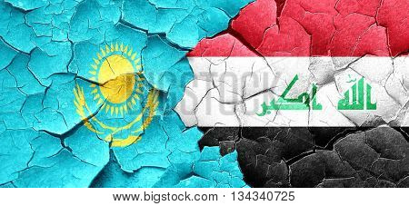 Kazakhstan flag with Iraq flag on a grunge cracked wall