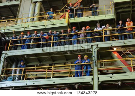 ST. PETERSBURG, RUSSIA - MAY 31, 2016: Workers of Admiralty Shipyard watch the ceremony of launching the new submarine Kolpino stayed on the ways. The submarine will be included in the Black Sea Fleet