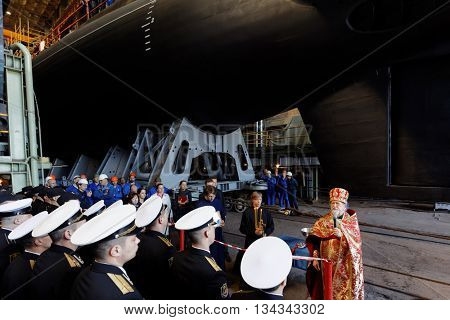 ST. PETERSBURG, RUSSIA - MAY 31, 2016: Priest and crew during the ceremony of launching the submarine Kolpino in the Admiralty Shipyard. The submarine will be included in the Black Sea Fleet