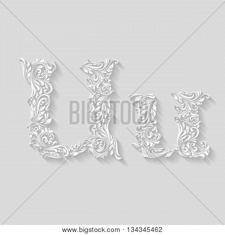 Handsomely decorated letter U in upper and lower case on gray