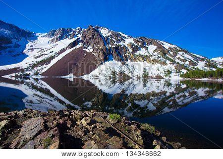 Grand Teton National Park, Wyoming. Reflection of mountains on Jackson Lake near Yellowstone.