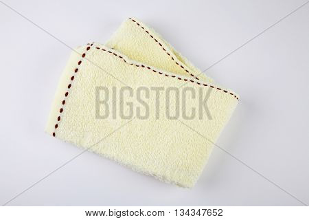 yellow towel on the white background