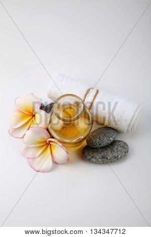 massage oil with frangipani and towel