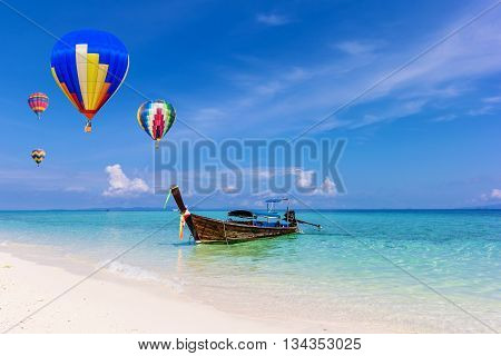 Colorful hot-air balloons flying over the sea at Krabi Thailand.