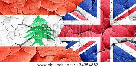 Lebanon flag with Great Britain flag on a grunge cracked wall