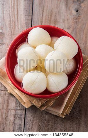 Bangladesh or india's favourite sweet rasgulla or rosogulla,  bengal sweets, made of milk / khoya, sweet meets poster