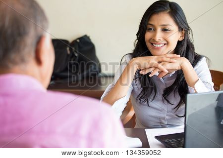Closeup portrait appointment with office manager job interview hiring isolated indoors office background. Getting that first job or excellent customer service with a smile