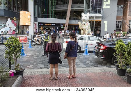 BANGKOK THAILAND - MAY 29 : people wait for walk across crosswalk opposite Siam Square One at siam square on may 29 2016 thailand. siam square is famous shopping place of Bangkok