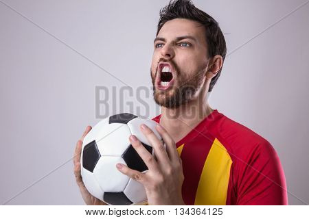 Young fan holding soccer ball
