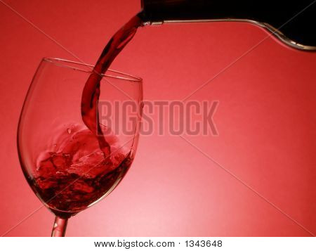 red wine pouring into the glass over red background poster