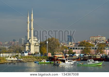 Istanbul Turkey - September 9 2012: Kadikoy pier. Protocol Haydarpasa Mosque in the background. Haydarpasa Protocol Cami.1873 year the mosque was destroyed in the construction of railways in 1982 it was rebuilt in the baroque and Ottoman style. The mosque