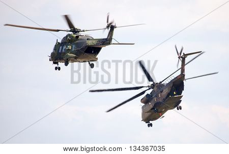 BERLIN / GERMANY - JUNE 3 2016: german military transport helicopters nh 90 and ch 53 flights in the sky in berlin / germany at june 3 2016.