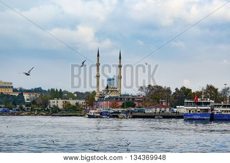 Istanbul Turkey - December 18 2012: Kadikoy pier. Protocol Haydarpasa Mosque in the background.Haydarpasa Protocol Cami.1873 year the mosque was destroyed in the construction of railways in 1982 it was rebuilt in the baroque and Ottoman style. The mosque