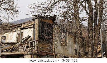 Dilapidated house after the fire. Architecture and streets of the city of Kislovodsk.