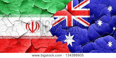 iran flag with Australia flag on a grunge cracked wall