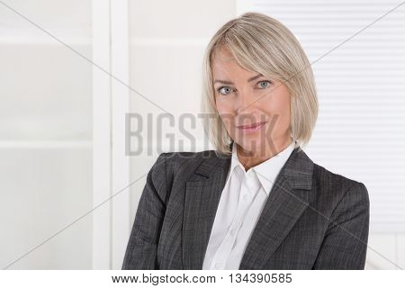 Portrait: Beautiful middle aged isolated businesswoman.