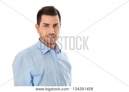 Attractive young businessman wearing blue shirt isolated over white background.
