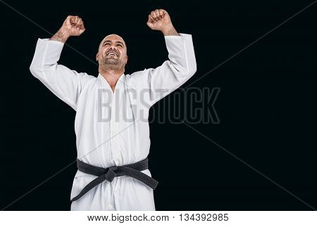Fighter posing after victory against black background