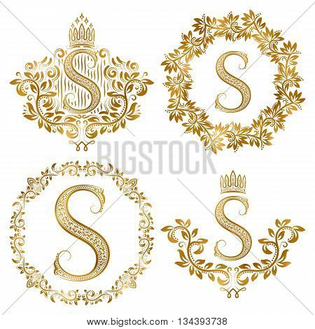 Golden S letter vintage monograms set. Heraldic coats of arms and round frames.