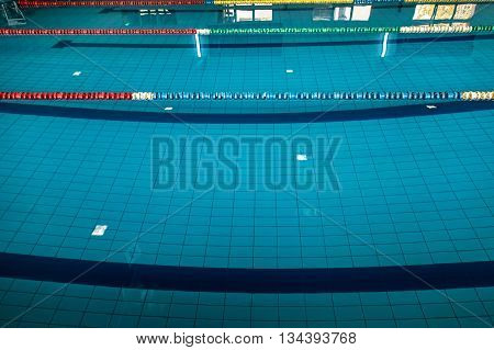 swimming pool lane lines background. Background With A Swimming Pool And Markers Between Lanes Competition. Lane Lines
