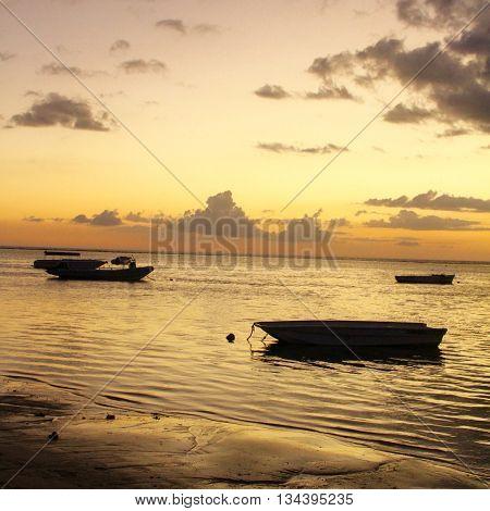 BOATS AT SUNSET , MAURITIUS ISLAND, FLIC AND FLAC