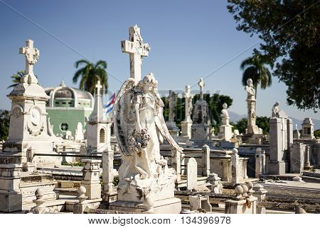 Cemetery of Santiago De Cuba decorated with beautiful white marble sarcophagi and statues