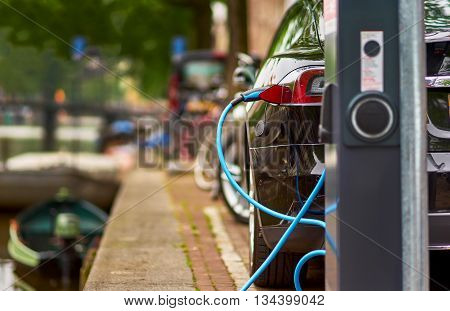 Electric Car Charging on the Street in Amsterdam Netherlands.