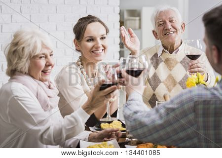 Family Making A Toast At Dinner