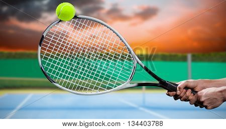 Tennis player playing tennis with a racket against digitally generated image of tennis court