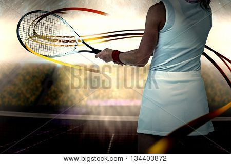 Athlete playing tennis with a racket against digitally generated image of supporters in tribune