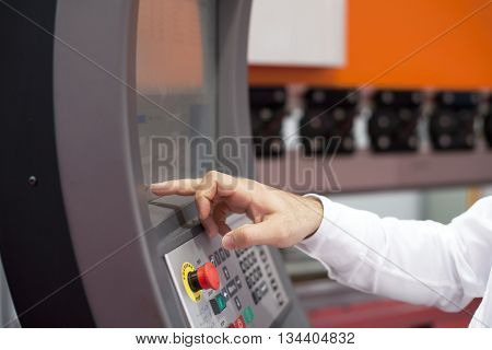 Programmable machine. Operator working at programmable machine.