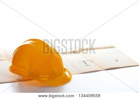 yellow helmet on a blue print with white background