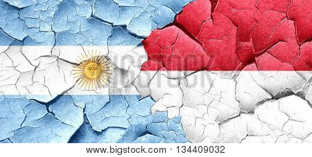 Argentina flag with Indonesia flag on a grunge cracked wall