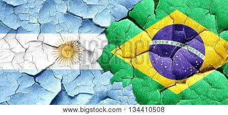 Argentina flag with Brazil flag on a grunge cracked wall
