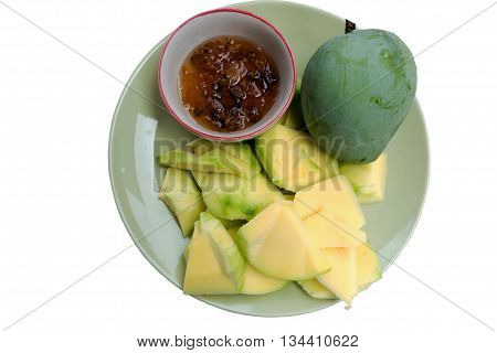 mangoes with sauce mangoes dipped into a sweet fishy paste with dried shrimp and red onions in plate