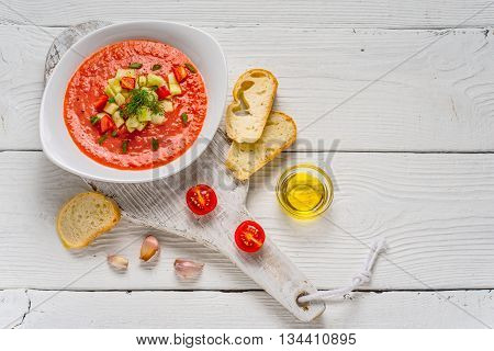 Vegetable soup gazpacho stand white bread on the boards horizontal