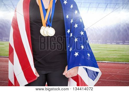 Athlete with gold medal against race track