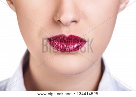 Beautiful woman lips with bright lipstik isolated on white
