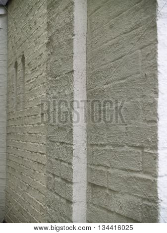 Beautiful textured plastered surface of a brick facade
