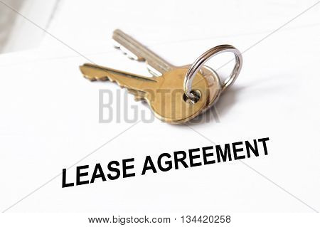 lease agreement document with set of house keys