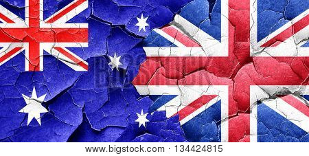 Australia flag with Great Britain flag on a grunge cracked wall