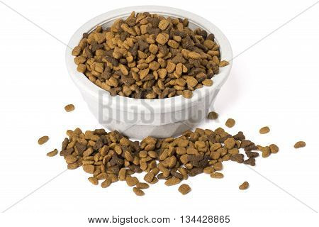 A bowl of dry cat food overflowing with food isolated on white with shadows.