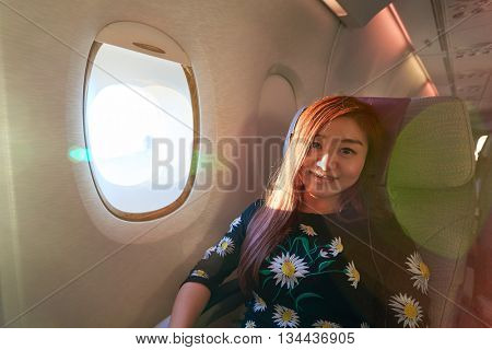 HONG KONG - MARCH 08, 2016: woman in Emirates Airbus A380. The Airbus A380 is a double-deck, wide-body, four-engine jet airliner manufactured by Airbus. It is the world's largest passenger airliner.